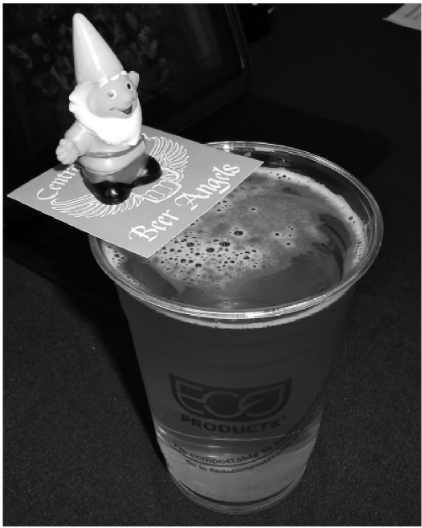 A photo of craft beer during Central Oregon Beer Week, with a gnome prize on top.