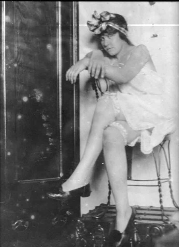 The only remaining photo from a collection of parlor photos commissioned by a Galveston madam; the photos were hung up in the parlor of her house for men to peruse and make their selection.