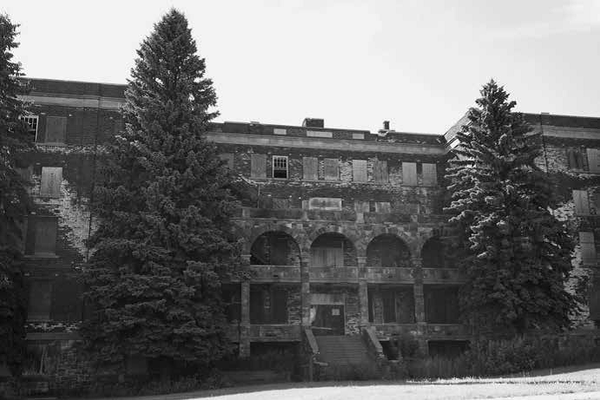Before the Holy Family Orphanage became apartments, it languished in disrepair.