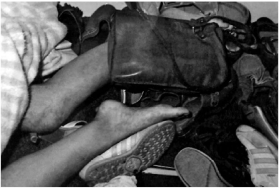Maggie Hume in the closet. Jay Carter had previously looked for her shoes in the closet. He would have seen her legs while looking for the shoes, but mysteriously, he didn't.