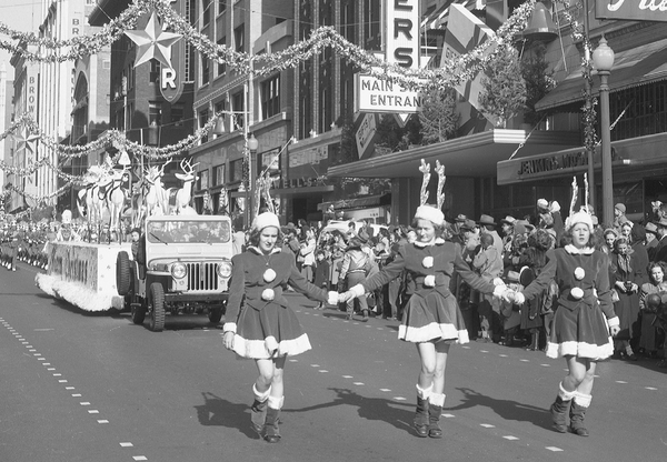 This photo shows some of Santa's helpers on South Main Street during the Tulsa Christmas Parade in 1949.