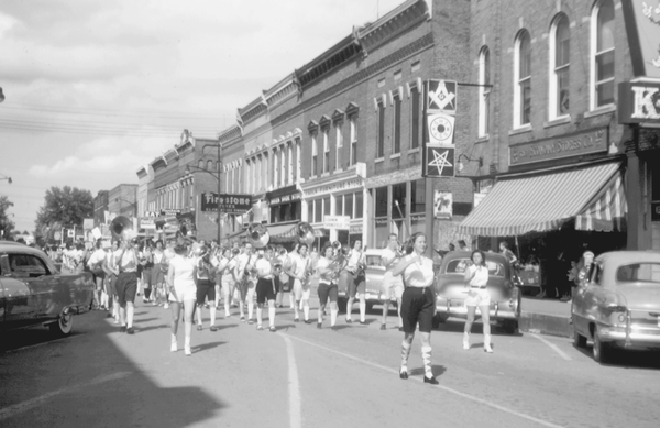 Gayle Creel walks ahead of the Campbellsville High School Band in Campbellville's 1957 Fourth of July parade.