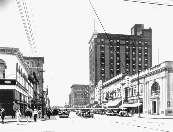 This 1920s photo shows the Poinsett Hotel towering over Main Street in Greenville, South Carolina.