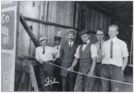 Orville Wright (center left).