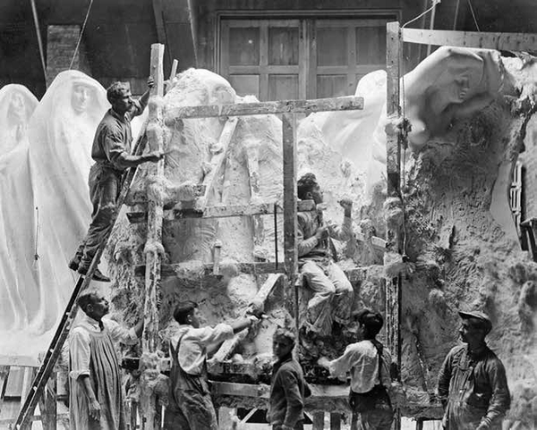 Lorado Taft and apprentices sculpting a portion of the Fountain of Time at Midway Studios, circa 1919.
