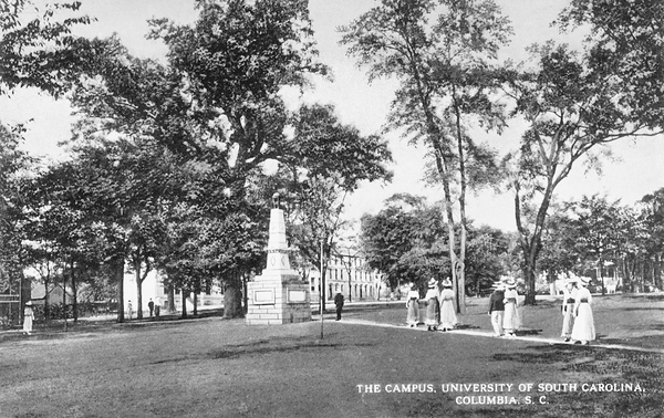 This early-20th century postcard shows students strolling around USC's campus horseshoe.