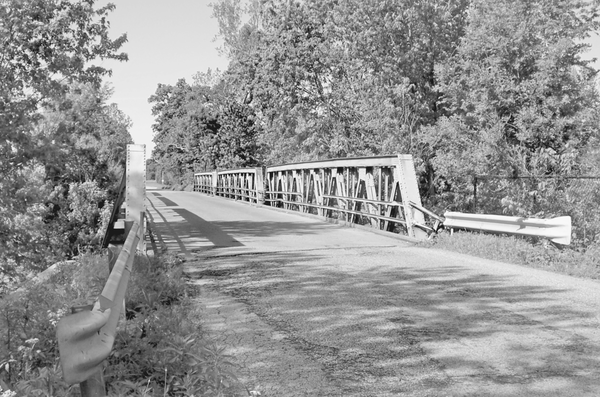 A section of the abandoned Dixie Highway in Indiana, featuring a one-lane, narrow bridge.