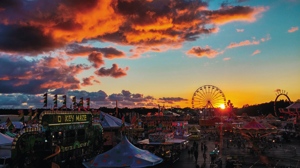 The midway and a late-summer sunset at the Erie County Fair in 2014.
