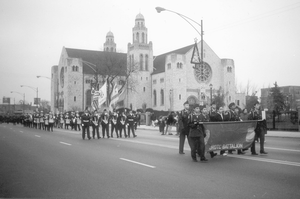 Here, the largest community parade in Chicago begins their holiday parade with a local high school band in 1999.