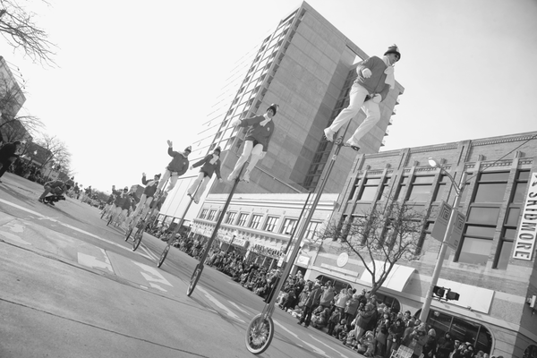 During the holiday parade in Royal Oak, Michigan, unicyclists fill the streets and perform tricks for onlookers.