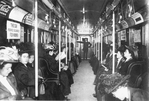Women riding one of the early New York City subways.