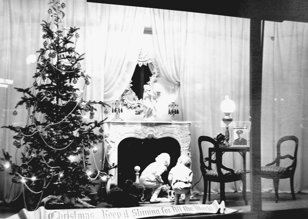 Store windows were also more sparsely decorated during wartime. In this 1940s Christmas window, Rochester's McCurdy's has opted to forgo using any icicles in their display. The metal typically used for the icicles was instead put towards the war efforts.
