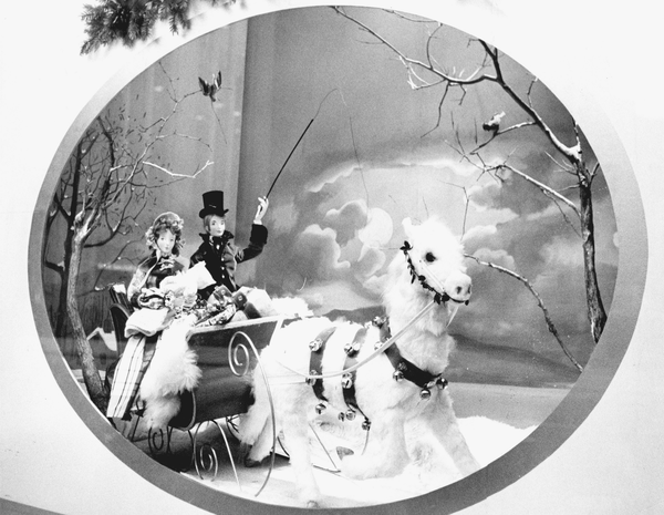 Although the art of department store windows has largely fallen by the wayside in the 21st century, many fondly remember afternoons and evenings spent gazing into beautifully crafted scenes celebrating the holiday and winter season. In this Halle's window, a traditional sleigh ride heralds the arrival of winter festivities.