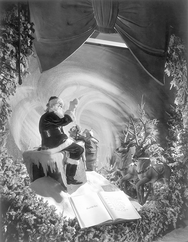 """Many holiday window displays would center around various storylines, drawn from classic holiday tales. For the Marshall Field's Christmas on State Street 1945 windows, the store told the story of Clement C. Moore's """"T'was the Night Before Christmas."""""""