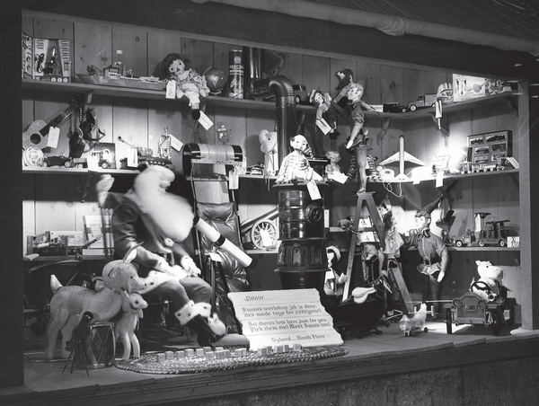 Besides Christmas Nativity scenes, Santa was also a popular favorite for many store windows, typically showcasing his workshop or his Christmas Eve sleigh ride. In this photo of a Kaufmann's department store window, Santa is surrounded by the toys he's created for the children and store.