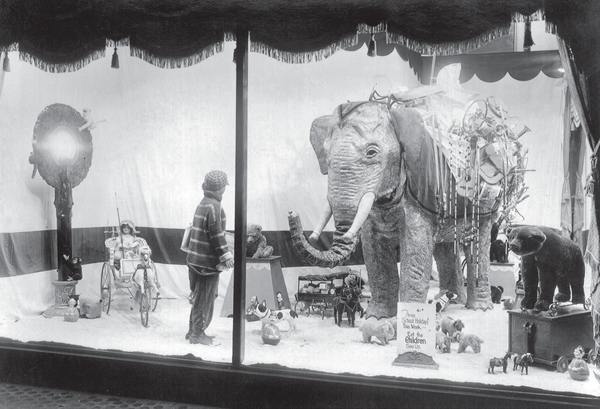 As the world began to become smaller in the wake of the two World Wars, many stores began to feature exotic scenes of distance countries. In this 1940 Christmas display, Dayton's department store has included an elephant as their display centerpiece.