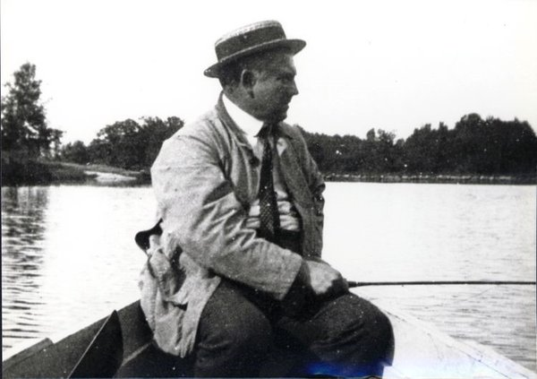 A rarely-seen photograph of Julian Alden Weir, some time after 1896, engaged in his favorite activity next to painting –  fishing in his own pond.   (Courtesy of Weir Farm National Historic Site).