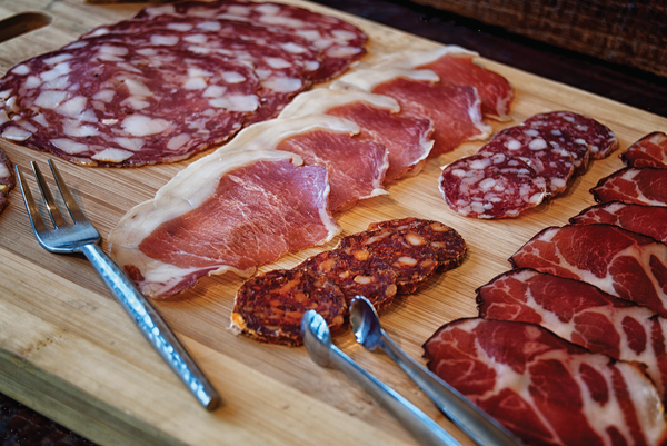 Wooden platter of salumi, Il Porcellino Salumi. Courtesy of John Poplin.