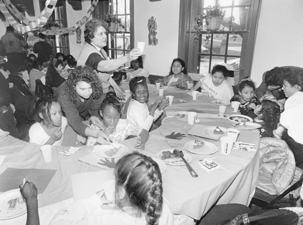 A group of children are hosted for a pre-Thanksgiving dinner at the University of Maryland.