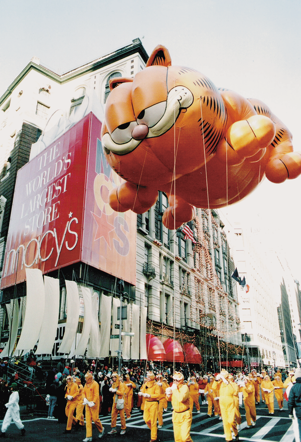 The Garfield balloon flies in the Macy's Thanksgiving Day Parade.