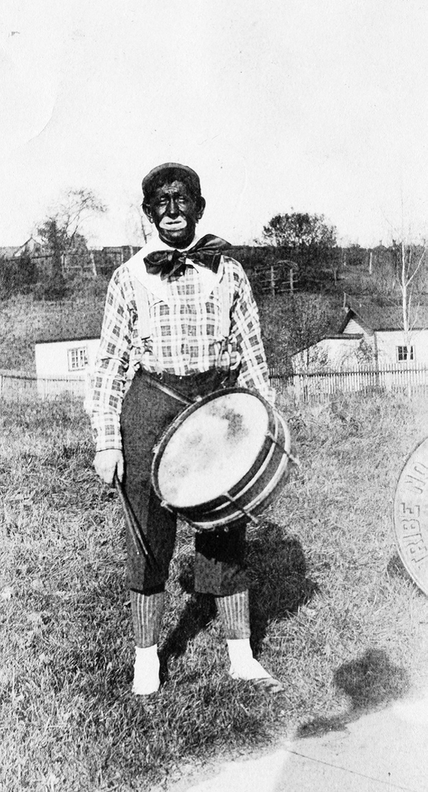 A minstrel performer in the early 20th century.