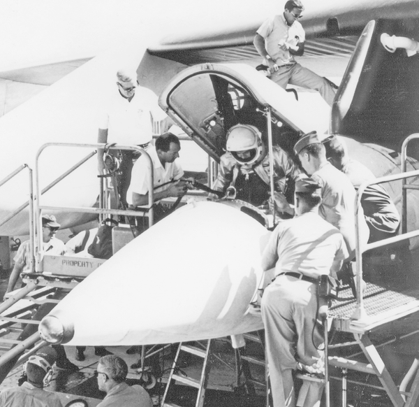 Airman Pete Knight lowers himself into the cockpit of an X-15A-2.