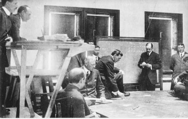 In this 1914 photo, a group of officer students play a naval war game as a part of their stories at the Naval War College in Newport.
