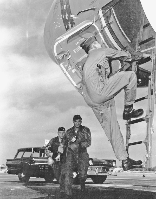 In this staged photo, a three-man B-47 alert crew arrives at their aircraft.