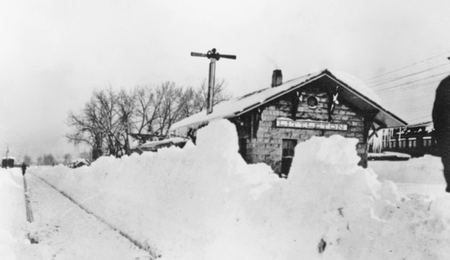 A buried train depot during the 1913 blizzard of Littleton, Colorado.