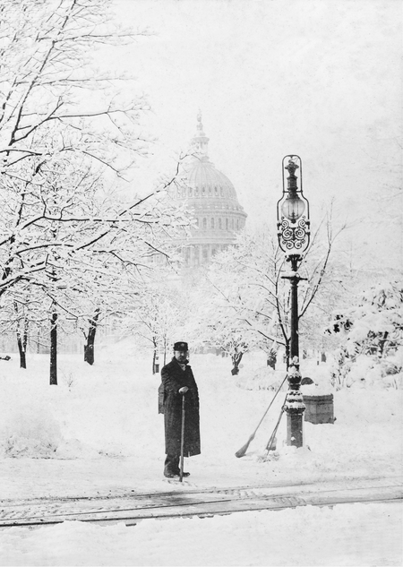 An attendant waits to fix telegraph wires during an 1888 blizzard in Washington, D.C.