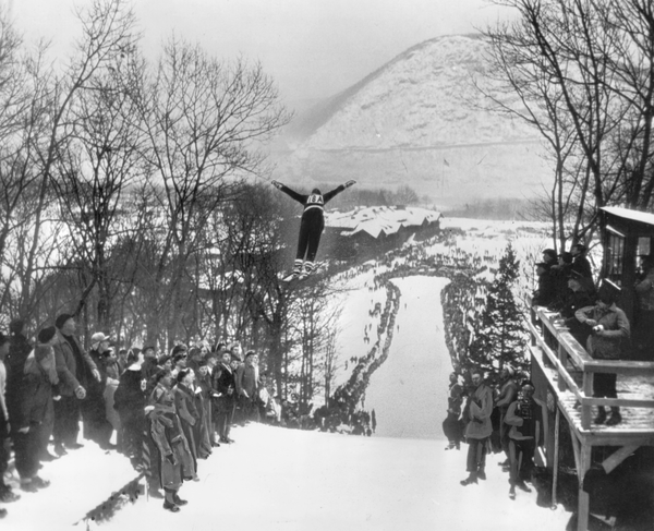 Ski jumper Odd Hirsheim begins a jump off the ramp at Bear Mountain State Park