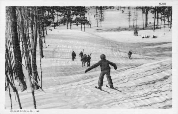 A group of skiers hikes up one of the Catskill mountains.