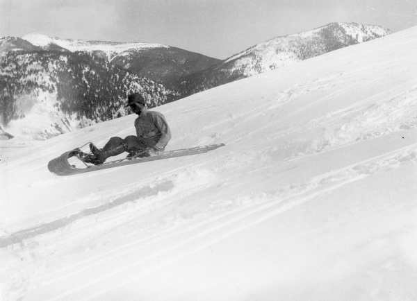 Fred Brand of the Western State Hiking and Outing club riding a toboggan in 1932.