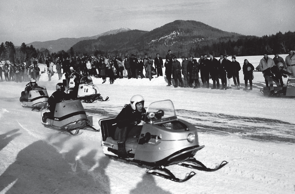 "Snowmobilers attending an organzied ""power sled meet"" in Lake Placid, New York."