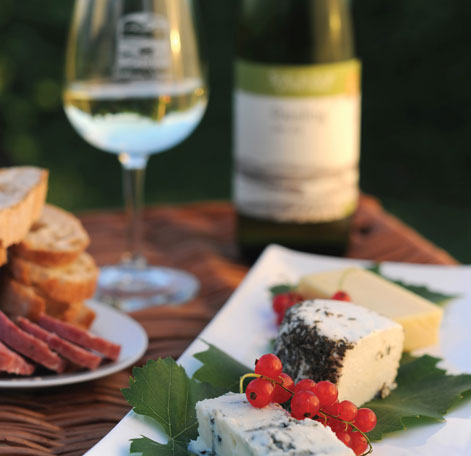 American Palate Series - Photo of tabletop filled with cheese, toast, and wine