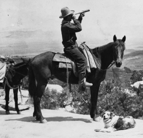 Images of America - Black and white photo of man on horse overlooking hills with a dog lying happily at the horse's feet