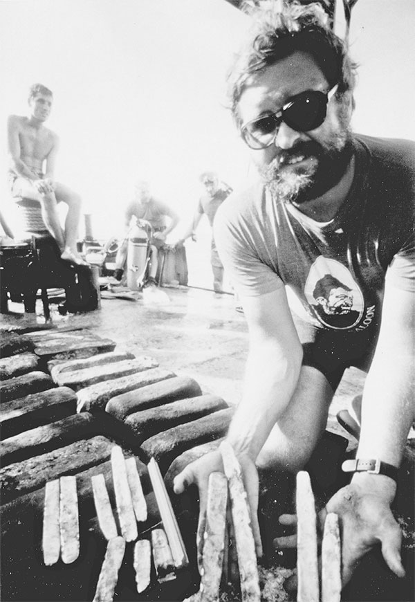 A treasurer salvager with gold and silver bars recovered from the Atocha shipwreck. Reprinted from Florida's Shipwrecks by Michael Barnette courtesy of Robert Weller (pg. 31, Arcadia Publishing, 2008).