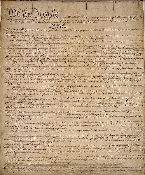 The first page of the US Constitution. Public domain image via Wikimedia Commons.