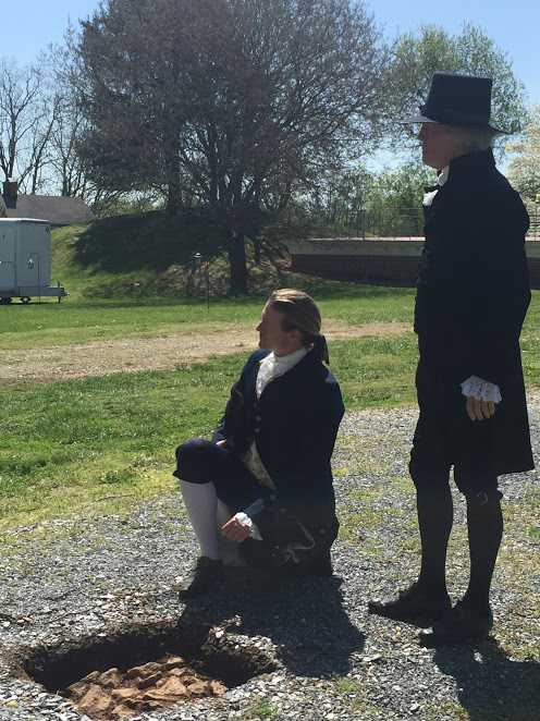"The ""young"" Thomas Jefferson as played by Kurt Smith, and the ""mature"" Thomas Jefferson, as played by Bill Barker, examine the original carriage turn-around at Poplar Forest, April 2018. Both Smith and Barker appear courtesy of Colonial Williamsburg. Photograph by Laura A. Macaluso."