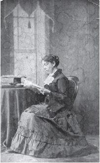 An image of Sarah Fairfield Hamilton surrounded by books. Reprinted from Laurel Hill Cemetery of Saco, Maine by Leslie Rounds and Emory Rounds courtesy of the Collection of Dyler Library/Saco Museum (pg. 89, The History Press, 2018).