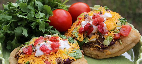 Indian tacos served on fry bread. Reprinted from The Big Sky Bounty Cookbook: Local Ingredients and Rustic Recipes by Chef Barrie Boulds and Jean Petersen, courtesy of Chef Barrie Boulds (pg. 79. The History Press, 2018).