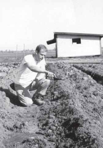 David Lett christening the first planting at Eyrie Vineyards in the Willamette Valley. Reprinted from Oregon Wine Country Stories: Decoding the Grapes by Kenneth Friedenreich (pg 37, The History Press, 2018).