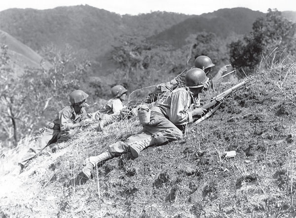American forces at the Battle of Luzon, 1949, one of many battles of the Pacific theatre during WWII. Reprinted from California Tiki: A History of Polynesian Idols, Pineapple Cocktails and Coconut Palm Trees by Jason Henderson & Adam Foshko, courtesy of Wikimedia (pg. 19, The History Press, 2018).