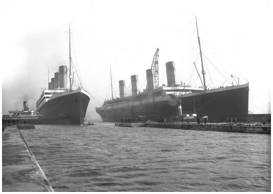 Titanic and Olympic together at Belfast. Possibly the only picture of the two sister ships together. Courtesy of Wikimedia Commons.