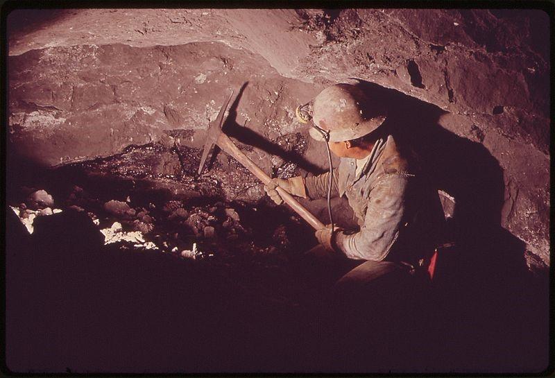An underground uranium miner. Public Domain image via Wikimedia Commons.